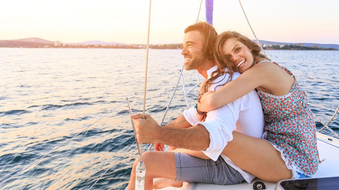newlywed couple on honeymoon sailing