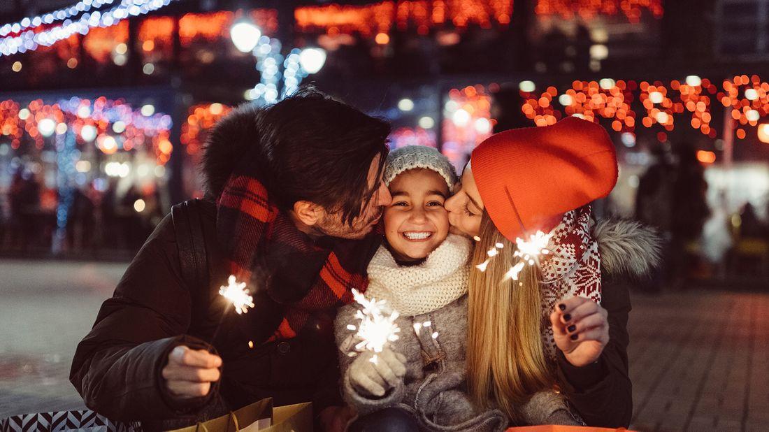 family holding sparklers
