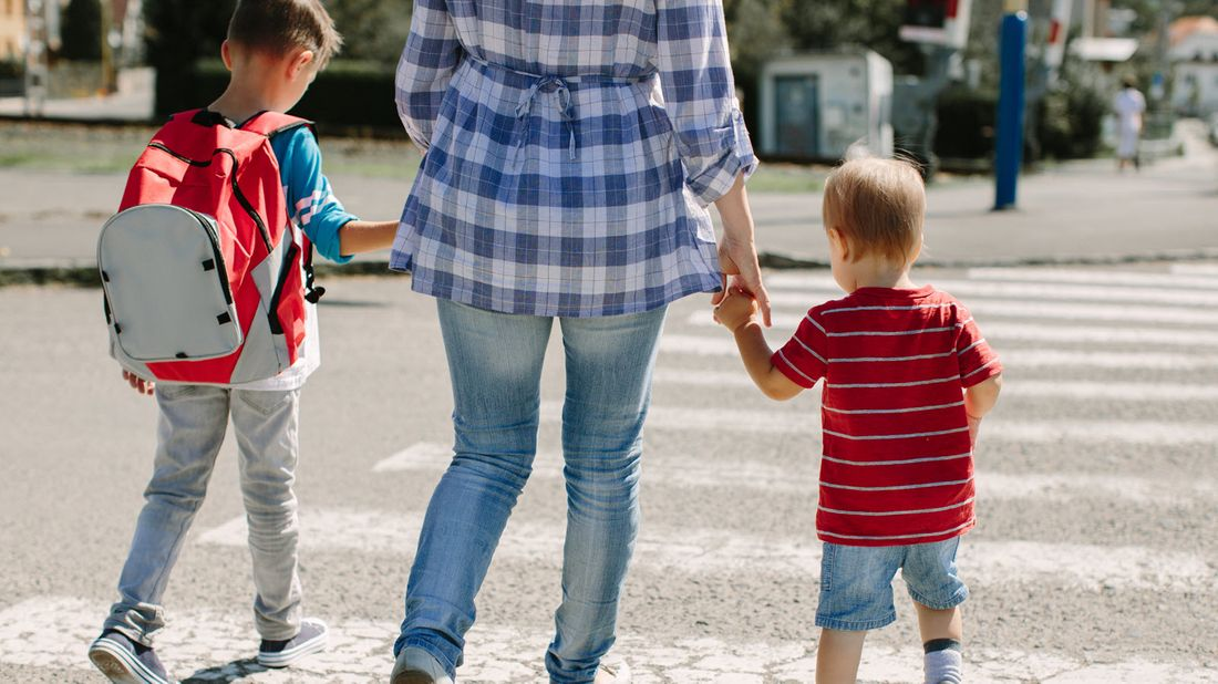 A mother and two children on first day of school