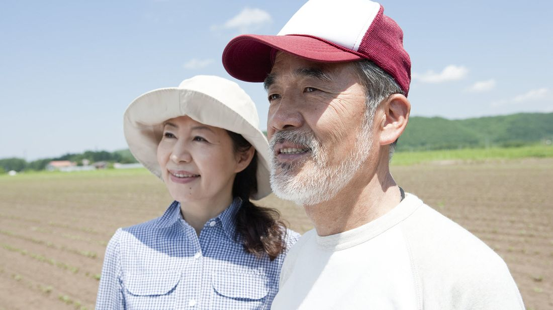 Couple on a farm thinking about how to use life insurance in retirement.