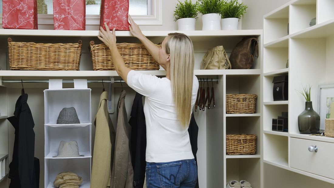 Woman organizing and decluttering her closet