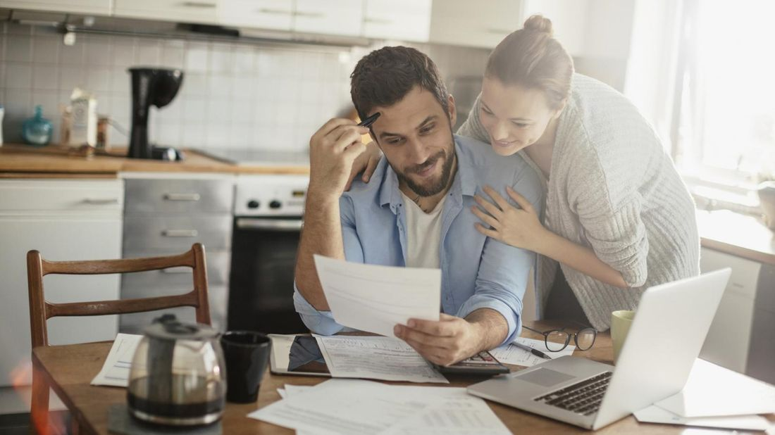 Couple trying to figure out their taxes.