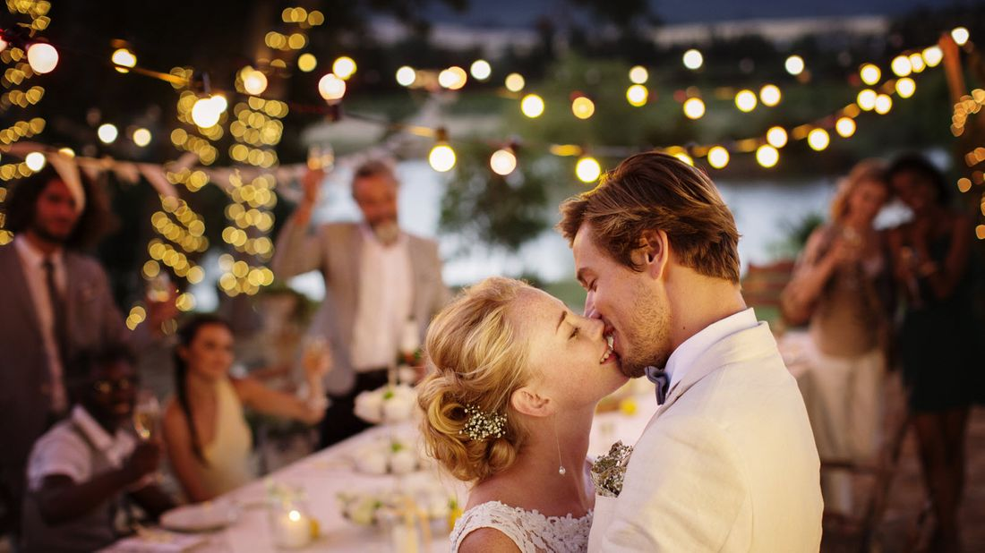 Young couple kissing during wedding