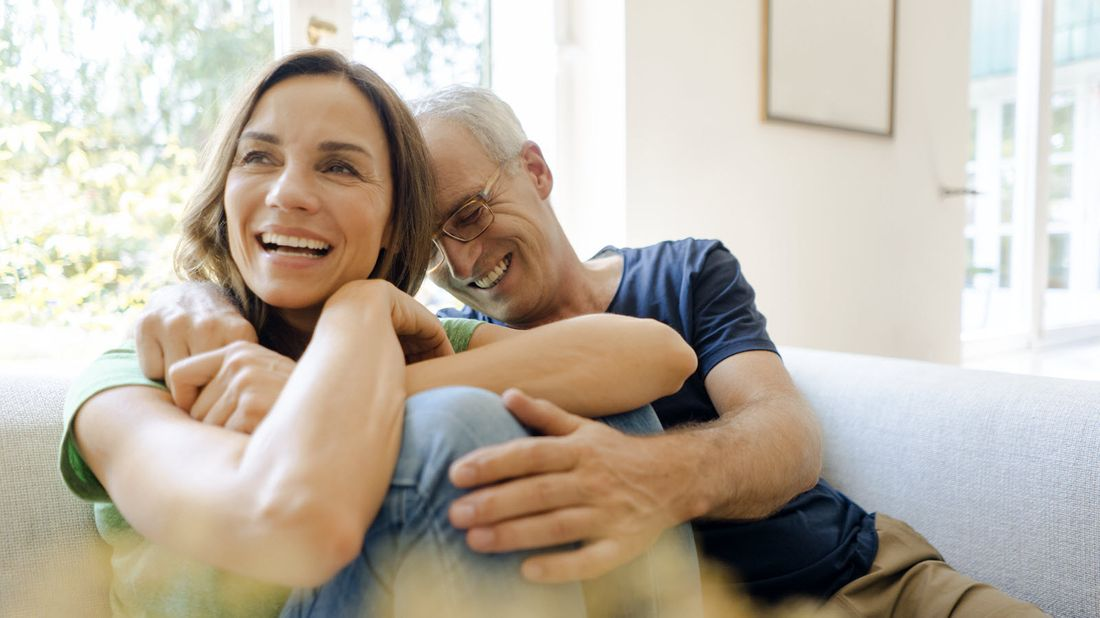 Couple at home considering what is an example of an annuity.