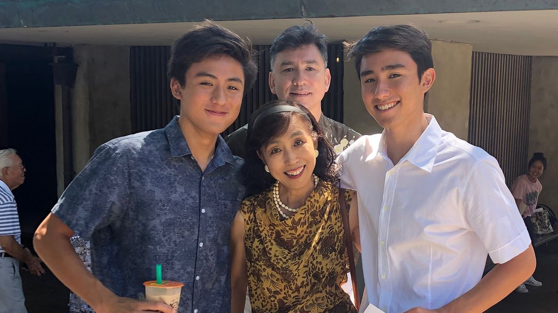 Akiko Sakamoto with her twin sons, Tyler and Ray, and husband, Gen.