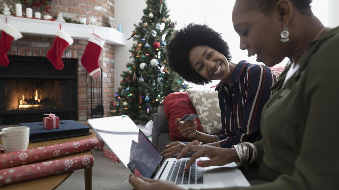 Mother and daughter shopping online for Christmas gifts