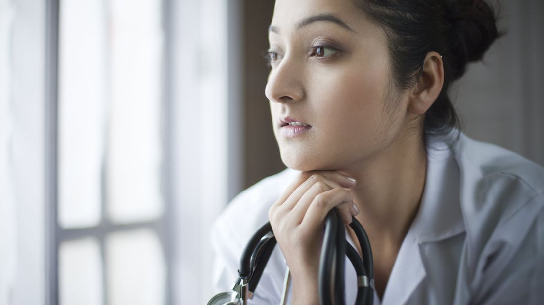Doctor considering how much disability insurance she will need.