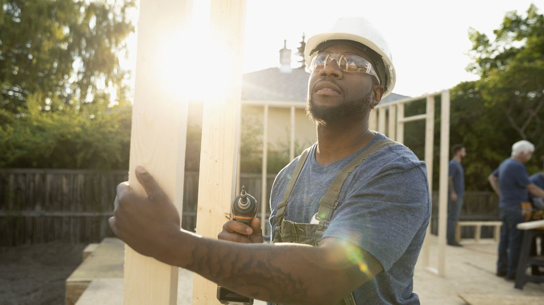 Man building a home.