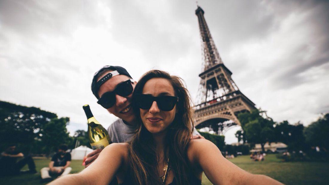 Young couple deciding to honeymoon in Paris.