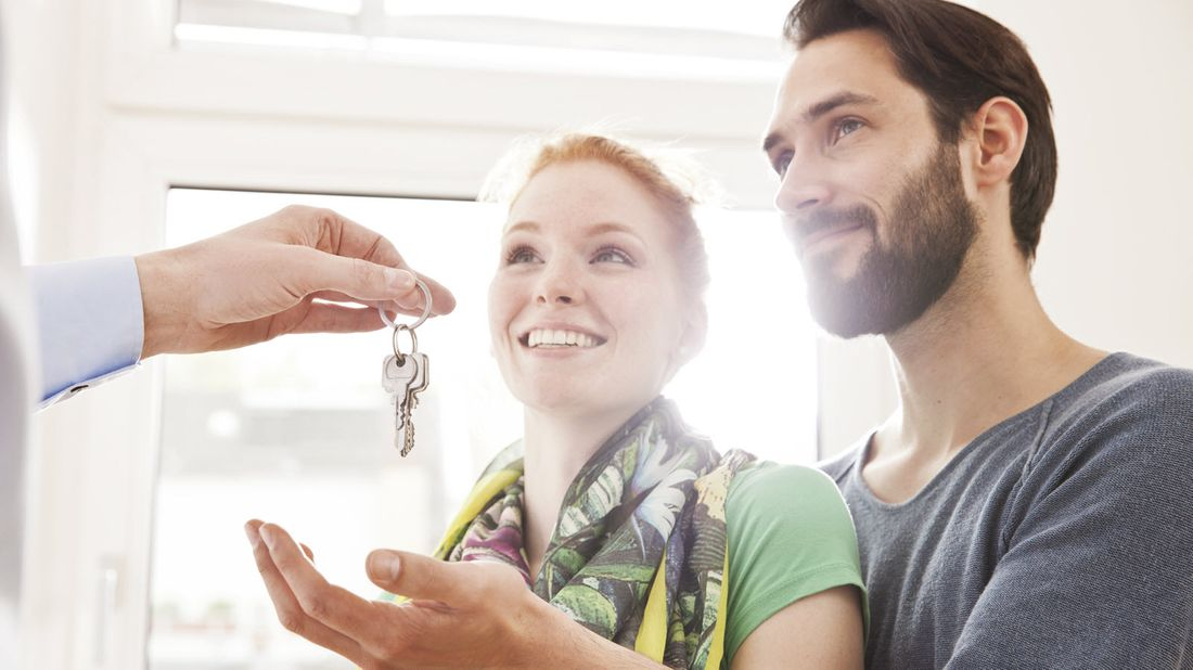 First-time home buyers getting the keys to their new home.