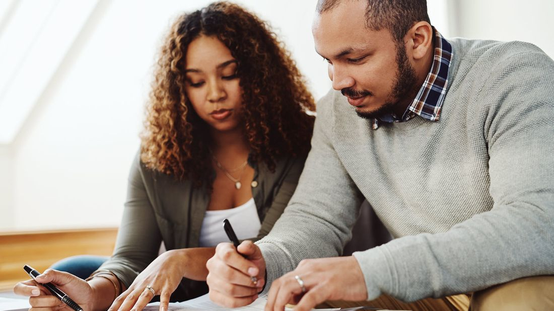 Couple going over their yearly tax checklist