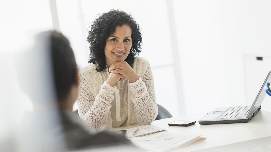 Woman sitting at a desk thinking about her passive job search