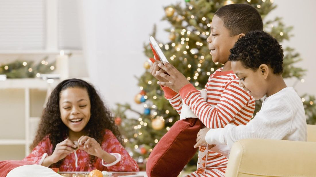 Kids opening meaningful gifts on Christmas.