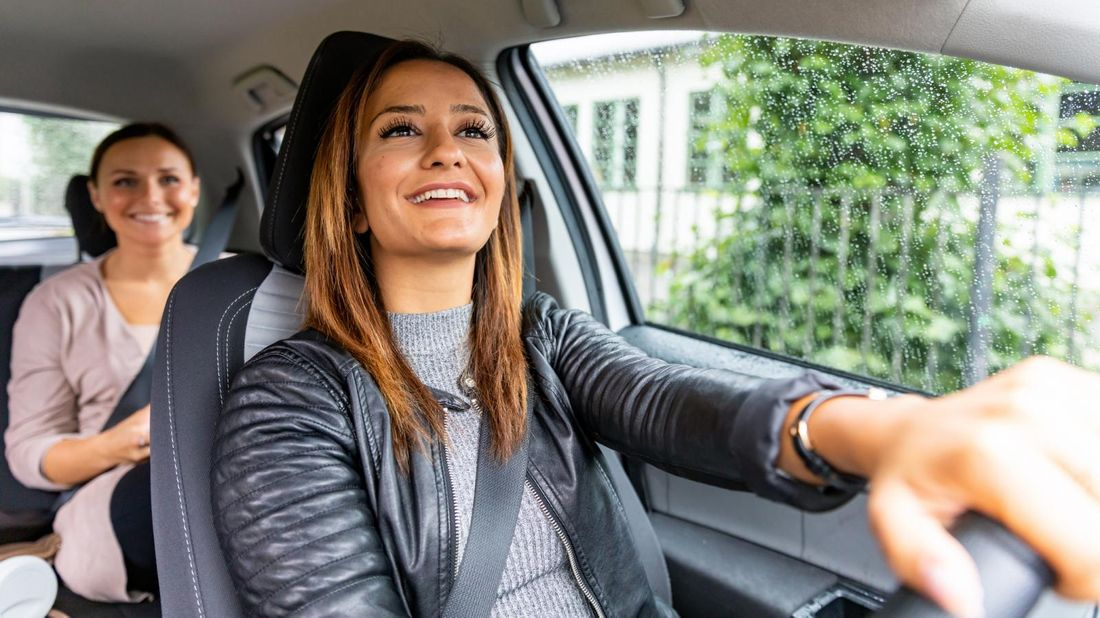 One woman driving another in her car as part of the gig economy