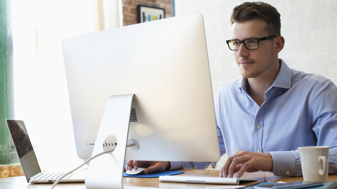 businessman sending emails from office