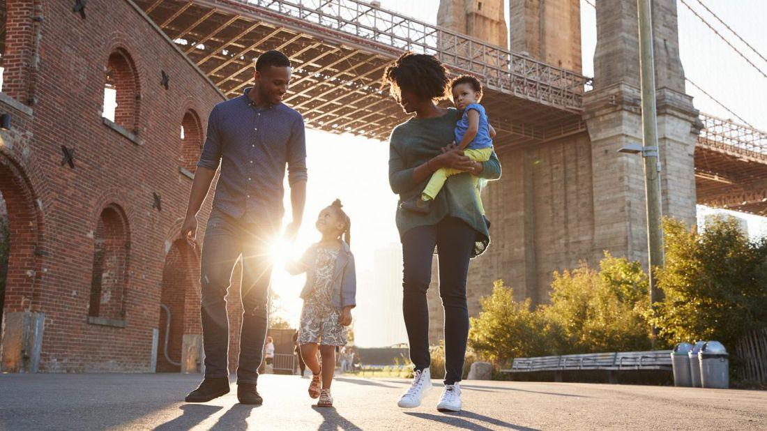 Family walking under a bridge