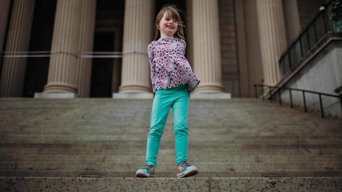 Girl on steps in Washington, DC on a financial vacation