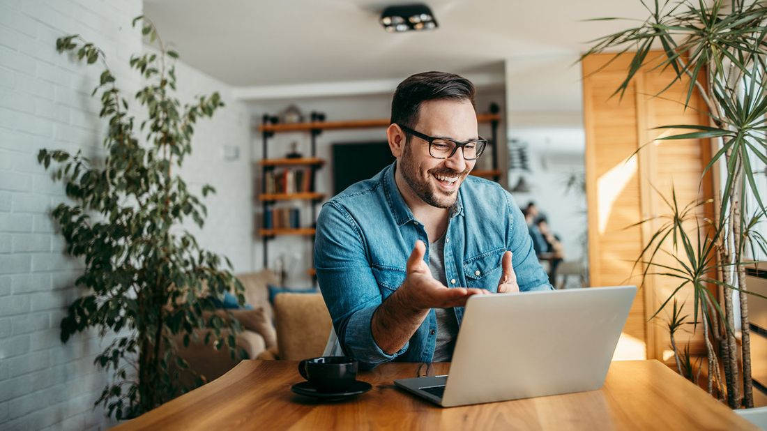 man smiling while having video call