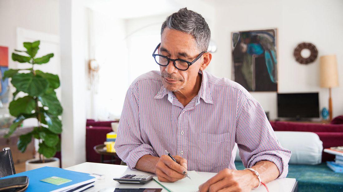 Investor reviewing his portfolio asset allocation