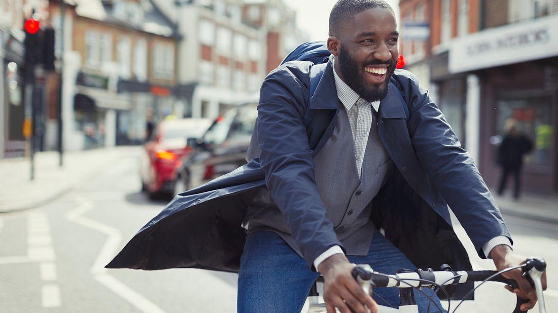 happy man biking to work