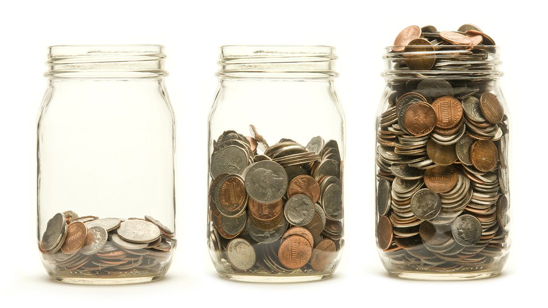 Three glass jars holding different levels of coins