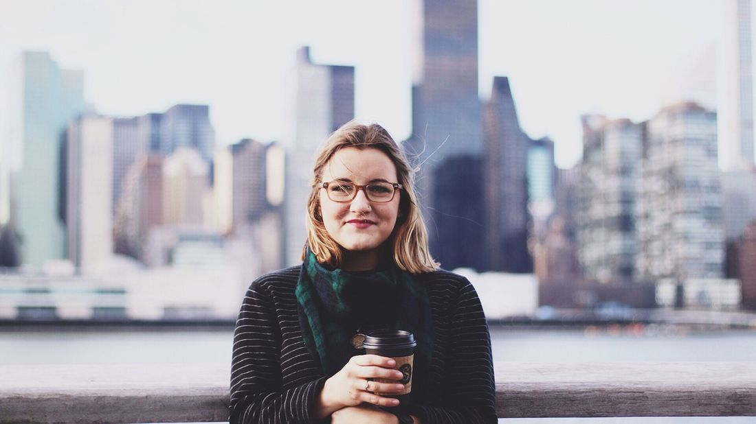 woman standing with city background