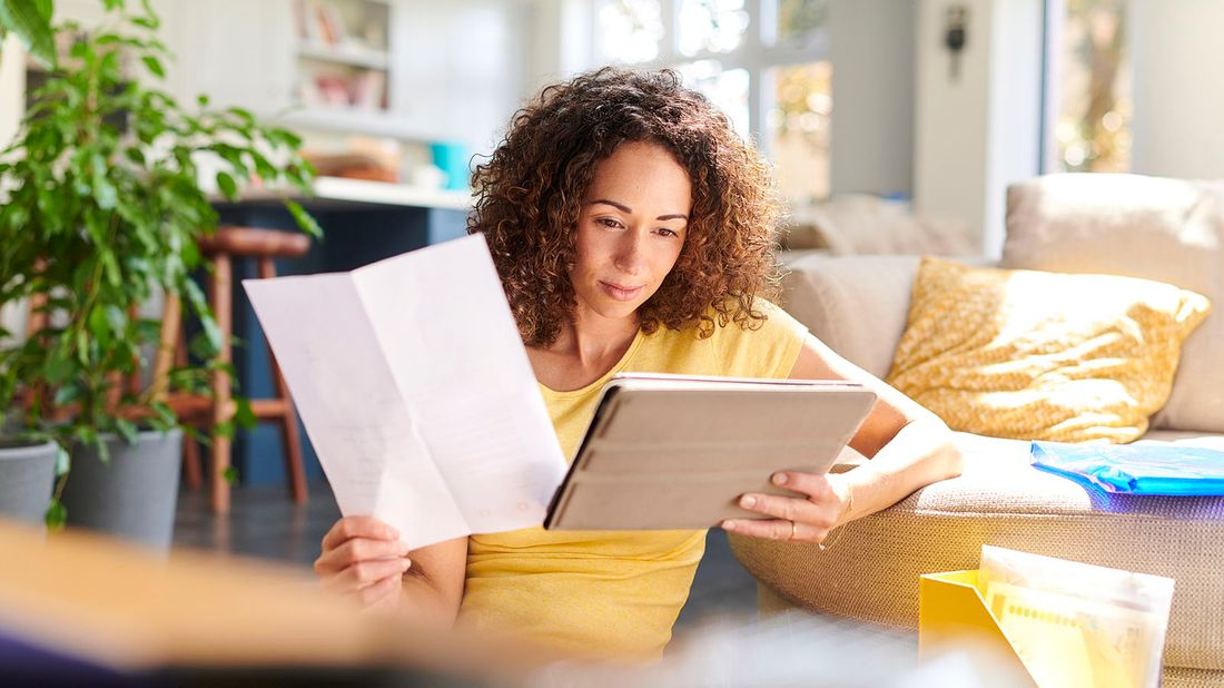 woman going over her finances at home