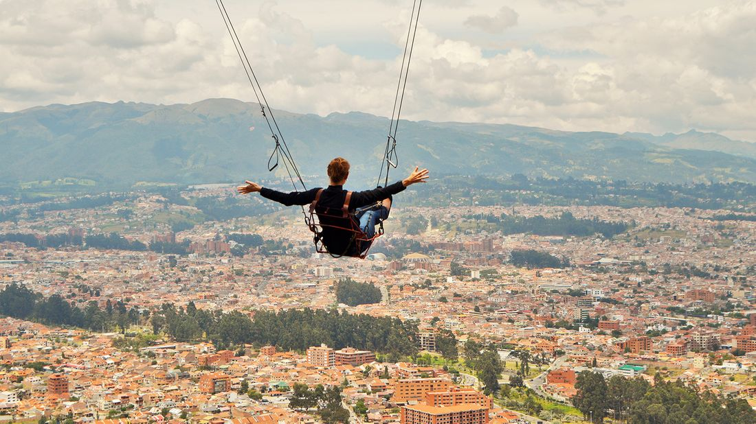 Stephanie Montague rides the giant swing in Cuenca, Ecuador.