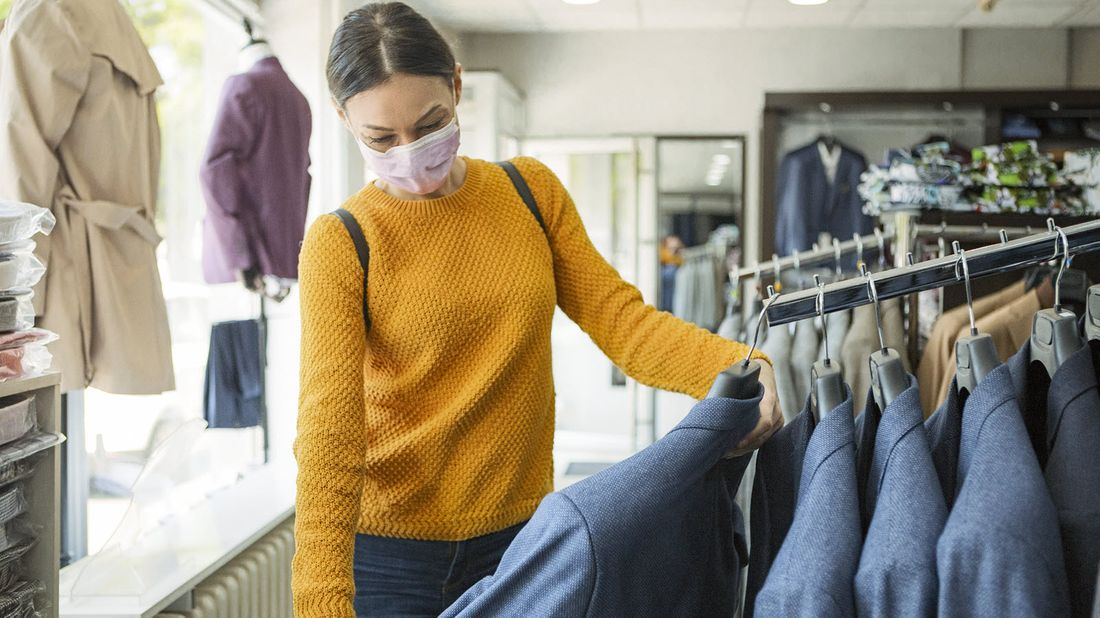 Woman wearing a face mask while shopping.