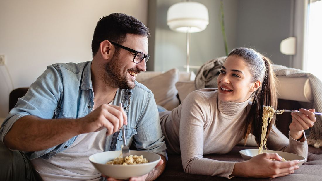 man and woman enjoying a takeout meal