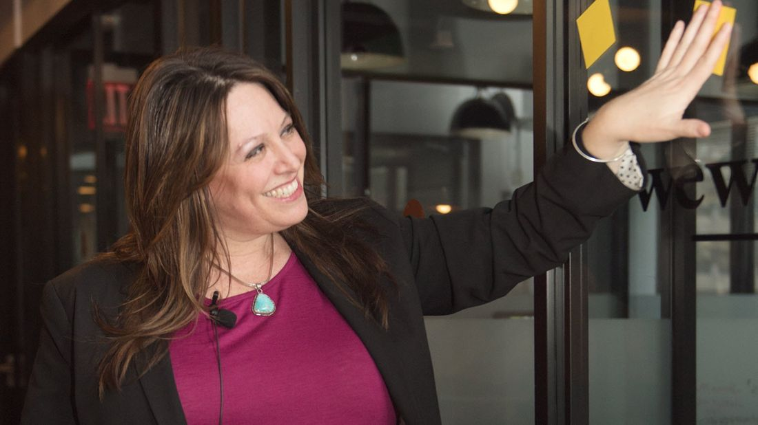 Entrepreneur Erica Wexler arranges post-it notes in her office