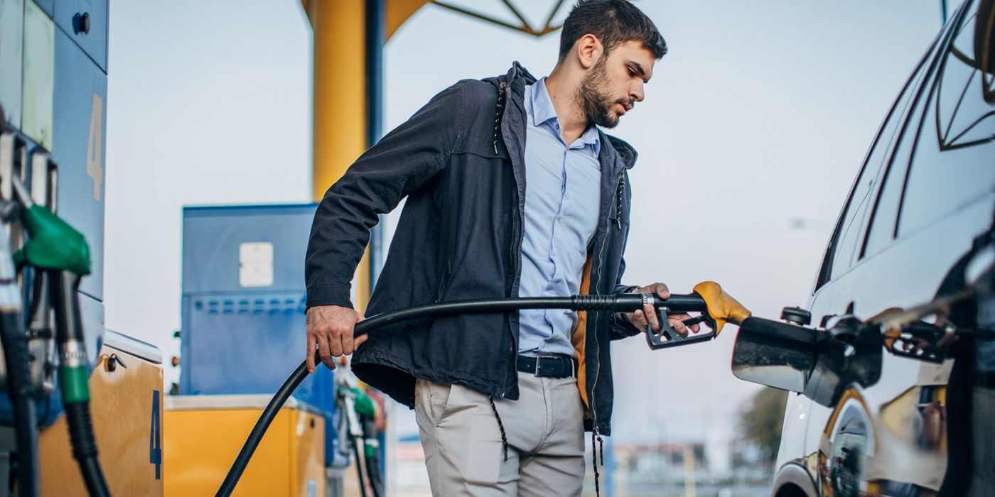 Man filling his gas tank at a service station