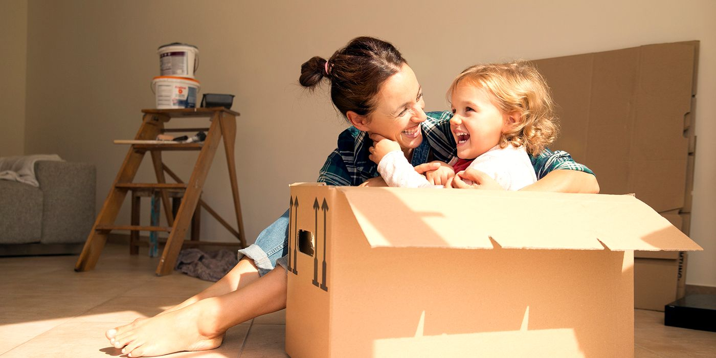 Mom with daughter in a moving box.