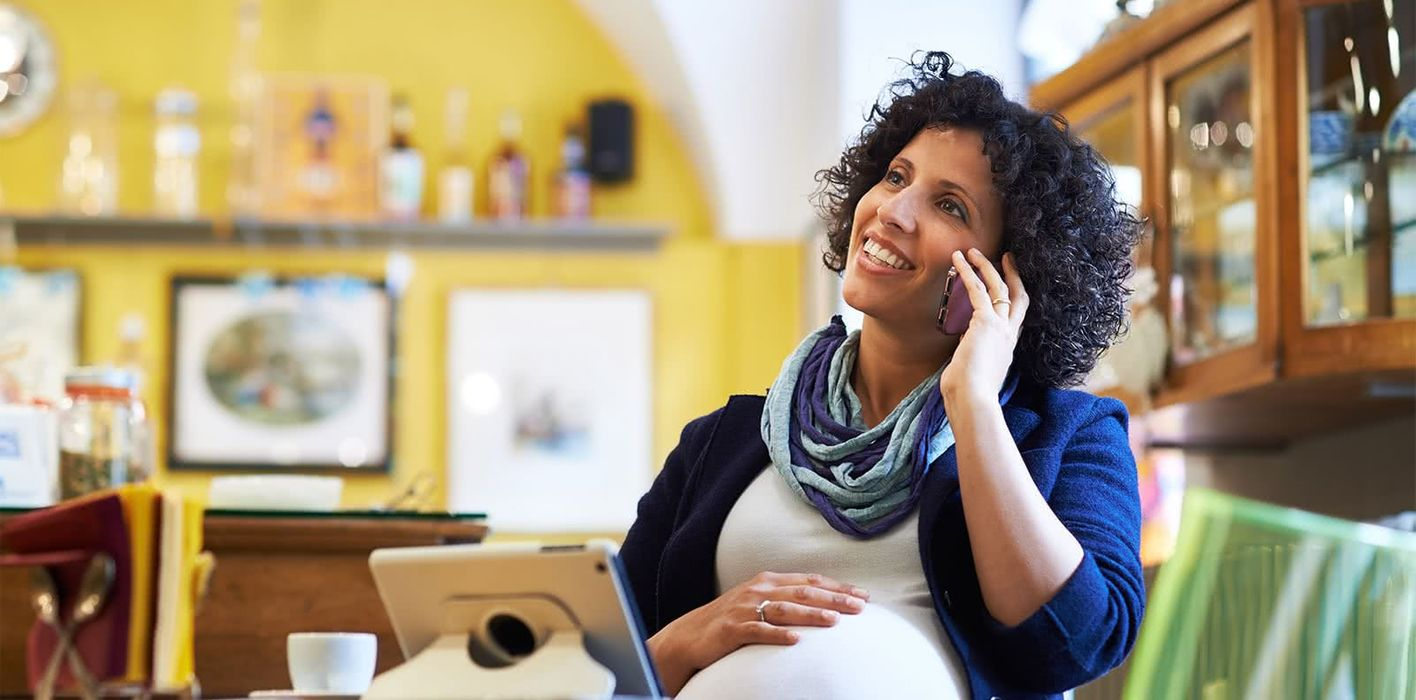 Pregnant woman discussing money musts before baby arrives