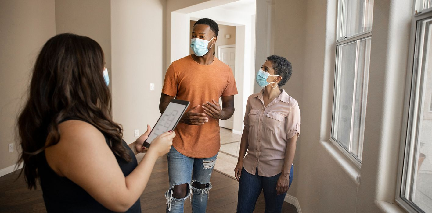 Homebuyers looking at a home during the pandemic trying to avoid homebuying mistakes
