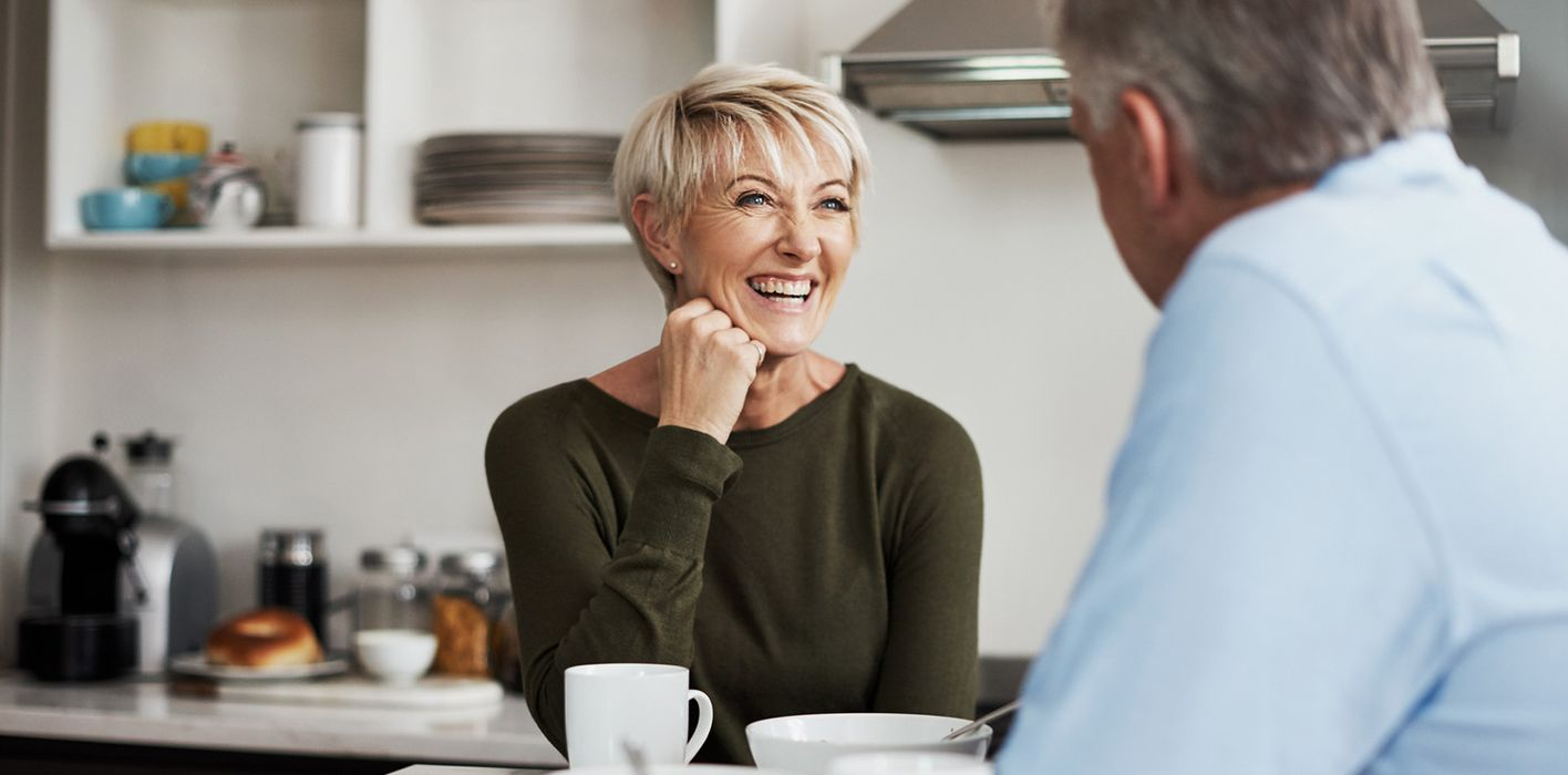 couple discussing retirement over breakfast