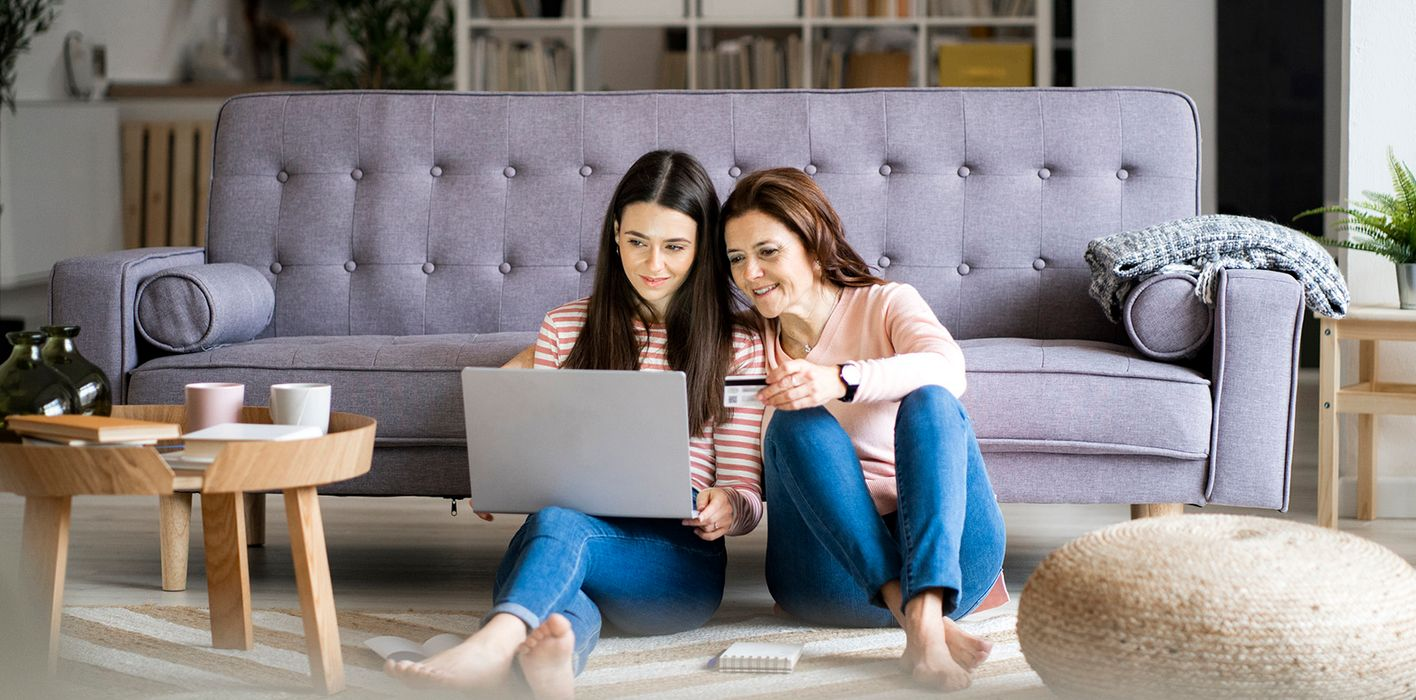 mother teaching daughter how to use credit cards responsibly