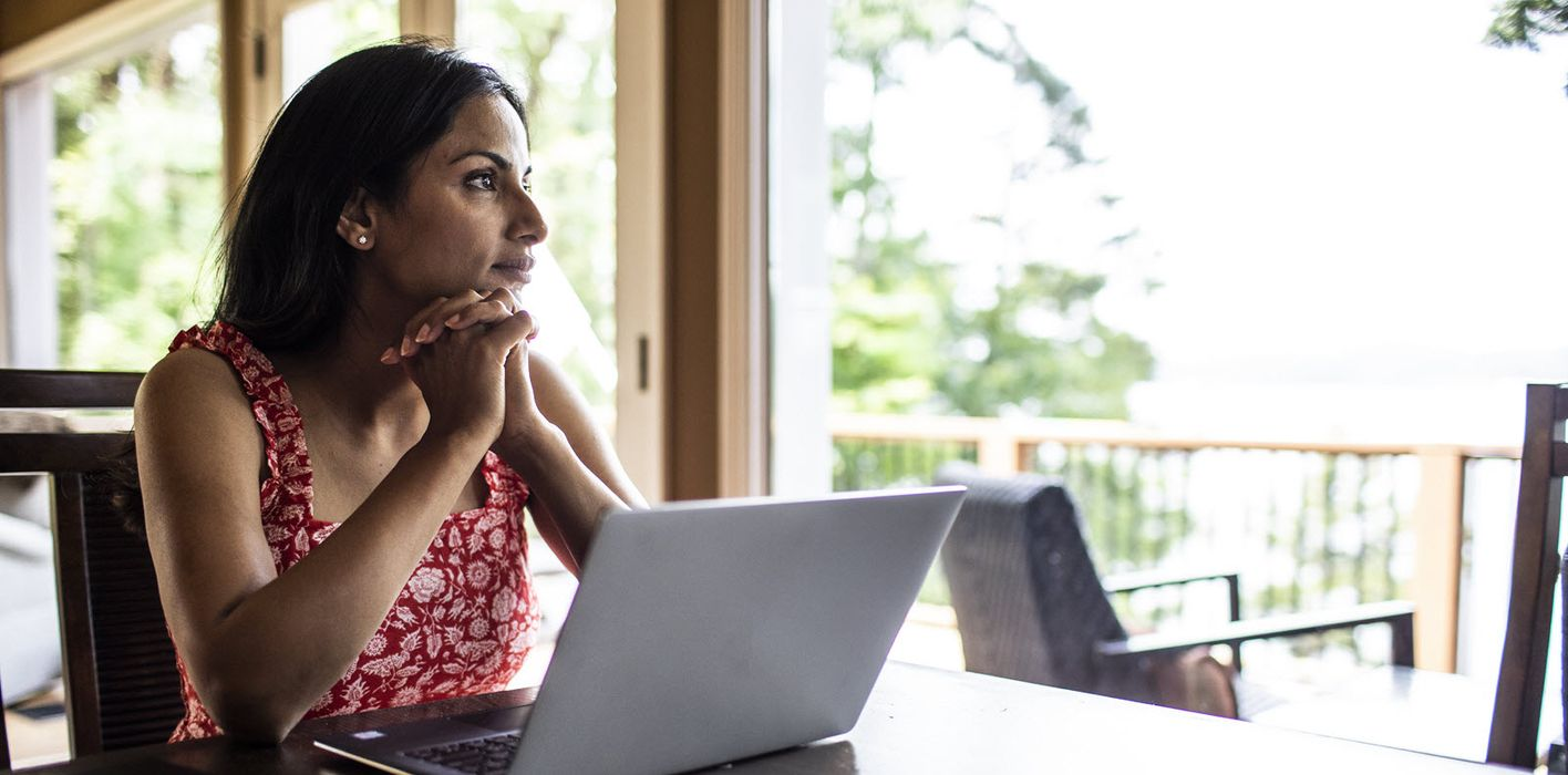 Woman reading Northwestern Mutual Market Commentary