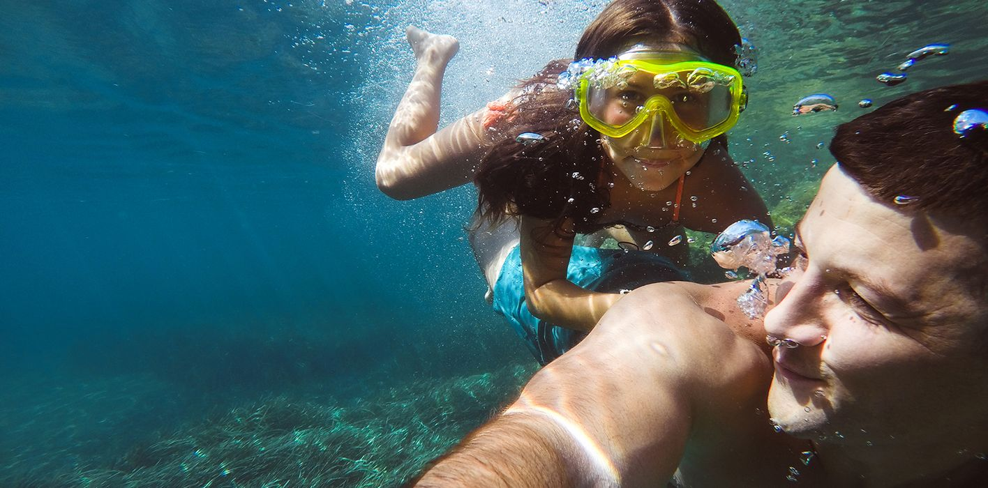 father and daughter swimming on spring break trip
