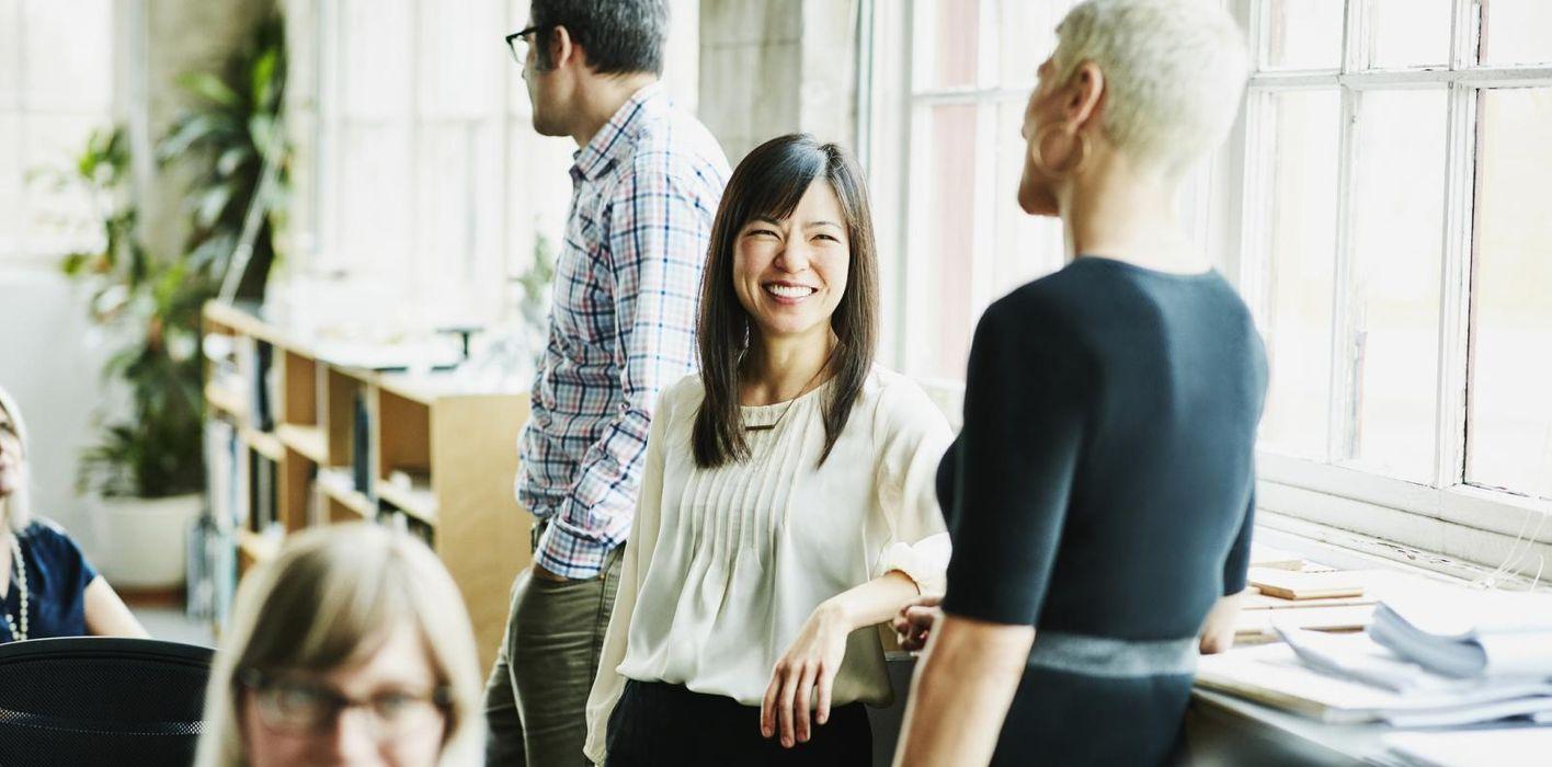 Key employee business women talking in business meeting