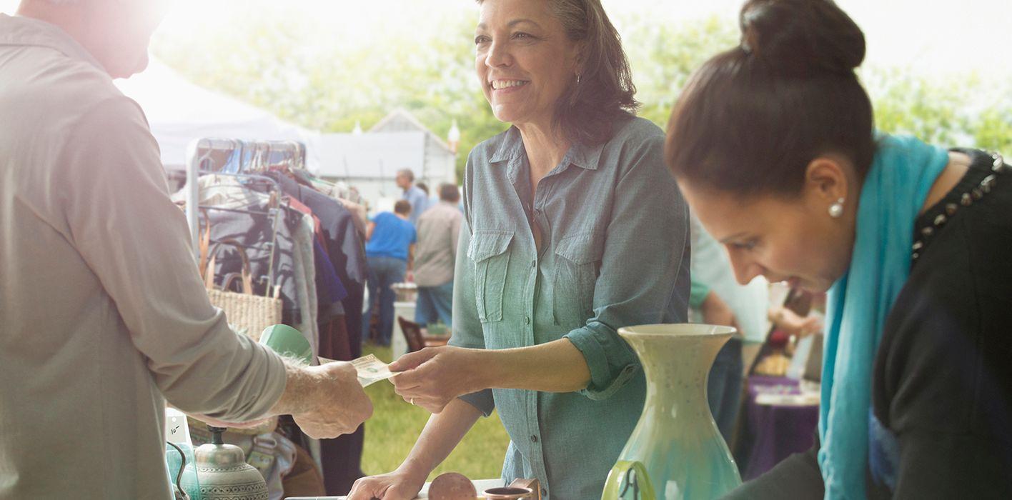 woman hosting garage sale