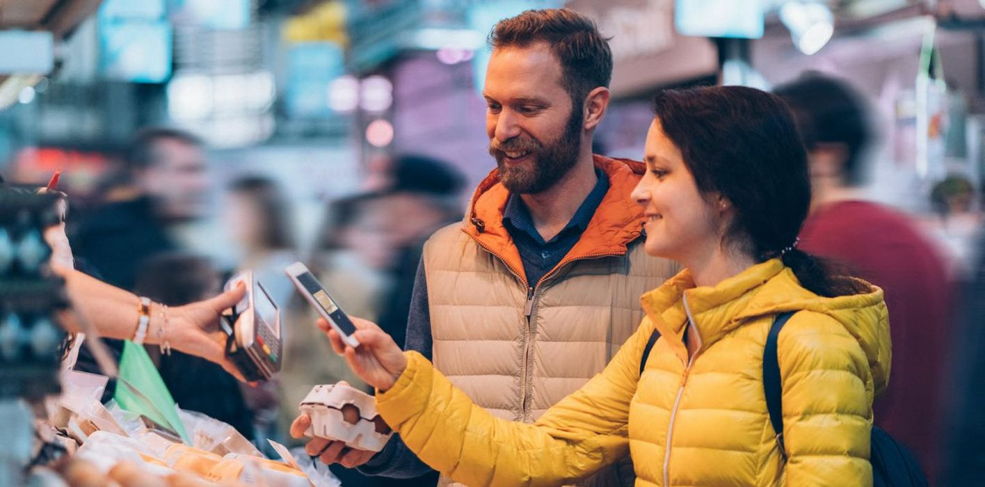 Young couple shopping and paying with their digital wallet