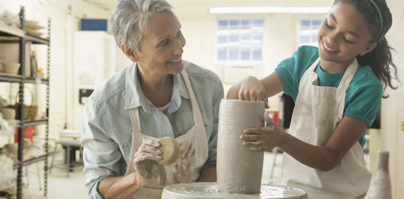 Grandmother and granddaughter doing pottery