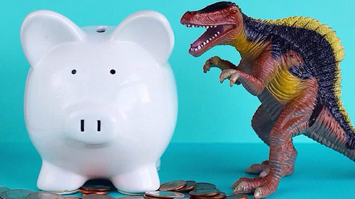 Piggy bank and toy dinosaur.