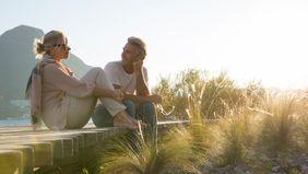 couple relaxing on boardwalk