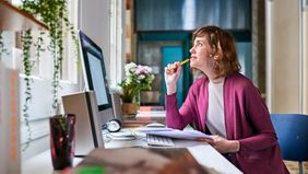 Woman working in upgraded home office