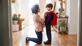 mother and son getting ready for school