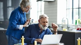 Couple using a laptop to research how does an annuity work?
