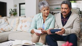 older couple researching annuities