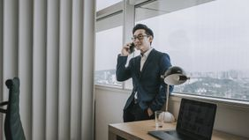 a man speaking with a potential wealth manager on the phone